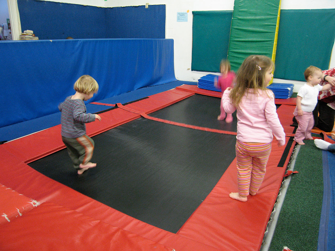 Children playing at the trampoline