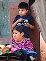 Boy with Mother in Market - Antigua Guatemala - Sacatepequez - Guatemala (15916140382).jpg