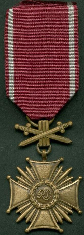 Cross of Merit with Swords (Poland) - Bronze grade of current Cross of Merit with Swords.