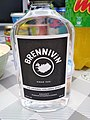 Brennevin 500ml bottle on the table with various icelandic foods in background.jpg