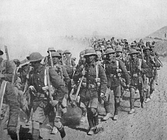 13th (Western) Division - British troops, possibly from the 13th Division, on the march in Mesopotamia.  In February 1916, the division was sent to Mesopotamia (modern day Iraq) to reinforce the Tigris Corps. This picture, possibly taken in 1917 because of the prevalence of steel helmets, show British soldiers on the march in Mesopotamia.