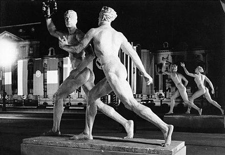 Statues representing the ideal body were erected in the streets of Berlin for the 1936 Summer Olympics. Bundesarchiv B 145 Bild-P017100, Berlin, Olympiade, Pariser Platz bei Nacht.jpg