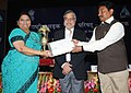 C.P. Joshi and the Minister of State for Road Transport and Highways, Shri Tusharbhai Chaudhary presented the Trophy for Road Safety to the Commissioner of Transport, Gujarat, Ms Ushmita A. Shah.jpg