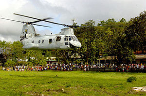 VMM-262 - A CH-46 from HMM-262 takes off from a field in Leyte as part of the humanitarian operations following the 2006 mudslides