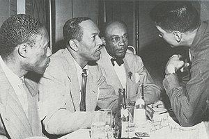Edmond Hall - At the Café Society, from left: Joe Williams, Andy Kirk, Edmond Hall, and John Hammond