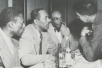 Edmond Hall - At the Café Society, from left: Joe Williams, Andy Kirk, Edmond Hall, and John Hammond