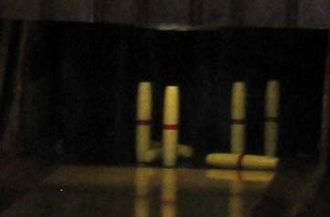"Candlepin bowling - Unlike in tenpin bowling, fallen or ""dead wood"" candlepins are not cleared away between balls during a player's turn."