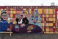 Caricatures on the side of a Wimpy's Restaurant in a working-class neighborhood of Dallas, Texas LCCN2015631030.tif