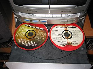 Compact Disc player carousel for three CDs.