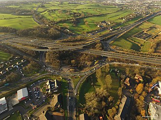 The Chain Bar Interchange on the M62, looking west, at the end of the M606, north of Cleckheaton Chainbar Roundabout.jpg