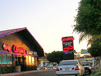 Exterior photograph of a strip club advertising full nude entertainment (Cheetah's, in San Diego, California