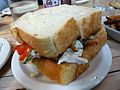 Chicken salad sandwich with gribenes and pickles.jpg