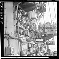 Crewmen laughing as they listen to pilots humorously describe encounter with Jap planes over bullhorn aboard the USS... - NARA - 520897.jpg