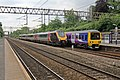 Cross Country Voyager and Northern Rail Class 323, 323235, Heaton Chapel railway station (geograph 4005085).jpg