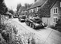 Cruiser Mk IV tanks of 5th Royal Tank Regiment, 3rd Armoured Brigade, 1st Armoured Division, drive through a Surrey village, July 1940. H2490.jpg