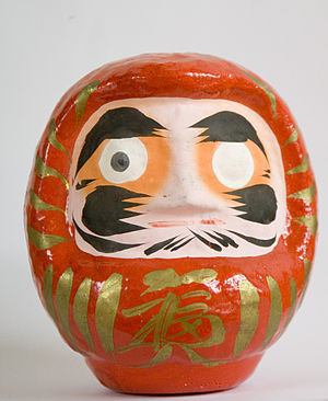 A traditional Daruma doll, with one eye filled...