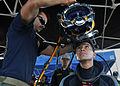 Defense.gov News Photo 120301-N-ZX920-475 - U.S. Navy Petty Officer 3rd Class Richard Burby assigned to Mobile Diving and Salvage Unit 2 Company 2-1 places a KM 37 dive helmet onto.jpg