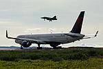 Delta Boeing 757 holds whilst a Czech Saab Gripen lands at Keflavik Airport.jpg