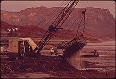 Dredging Up Debris at Log Boom near Point Where the San Juan River Enters Lake Powell, 10-1972 (3814160859).jpg
