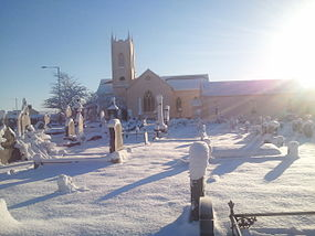 Drumachose Presbyterian Church from graveyard in December snow.jpg