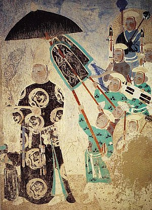 Uyghurs - Uyghur king of the Turfan region attended by servants. Mogao Caves, 409, 11th-13th century.