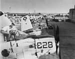 EA-1 Skyraiders of VAW-33 are readied for flight at NAS Quonset Point in July 1963.jpg
