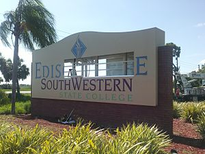 Florida SouthWestern State College - Crews change the Charlotte campus back entrance sign.