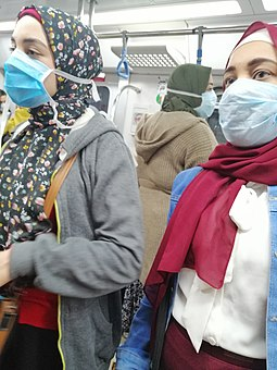 Women in Cairo wear face masks during the COVID-19 pandemic in Egypt in March 2020 Egypt Metro Covid19.jpg
