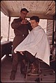 Ellis W. Mooney, 58, Besoco, West Virginia, near Beckley, Cuts the Hair of His Nephew, Kenneth Blivins, Who Was Born and Raised in Besoco But Now Lives in Detroit 05-1974 (3906444719).jpg