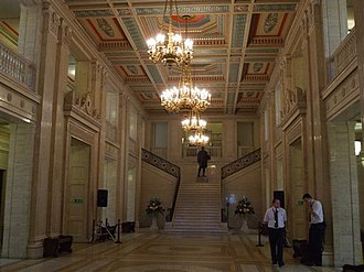 Parliament Buildings (Northern Ireland) - The Great Hall, originally called the Central Hall. A statue of The 1st Viscount Craigavon stands on the landing on the Imperial Staircase.
