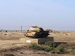 Exploded tank, remains in Abadan as symbol of Iran–Iraq War.jpg