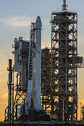 Falcon 9 and Dragon Vertical at Pad 39A (32945170805).jpg
