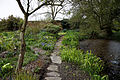 Feeringbury Manor garden path and pond, Feering Essex England.jpg