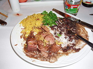 Latin American cuisine - A typical Brazilian Feijoada, a stew of beans with beef and pork