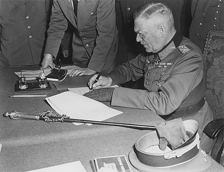 Keitel, signing the ratified surrender terms for the German Army in Berlin, 8/9 May 1945 Wilhelm Keitel Kapitulation.jpg