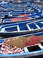 Fisherman boats neatly anchored in the harbour of the city of Essaouira, Morocco.jpg