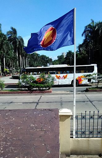Flag of the Association of Southeast Asian Nations - ASEAN flag in front of the Central Post Office building in Manila.