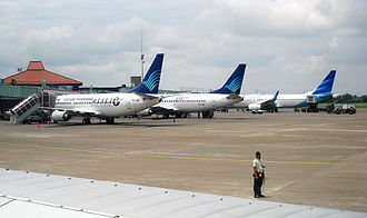 Garuda Indonesia - Comparison between Garuda's current and previous livery. Aircraft on right is in the current livery; the other two are in the airline's previous livery. (2010)