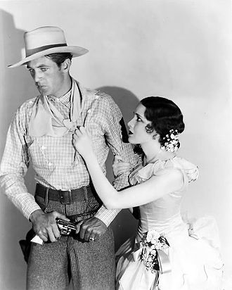 Mary Brian - Gary Cooper and Mary Brian in a film still for The Virginian, 1929
