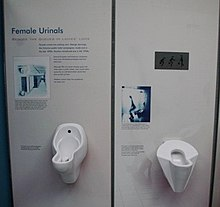 Two Different Designs Of Wall Mounted Female Urinals At An Exhibition