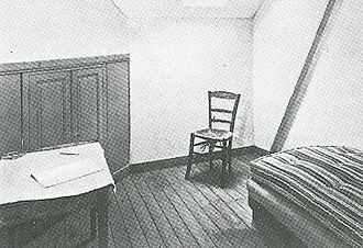 Jug in the Form of a Head, Self-Portrait - Photograph of the empty chair in van Gogh's room at the Auberge Ravoux in Auvers.