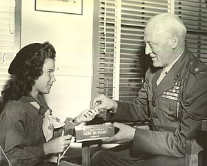 Graves Erskine and Girl Scout, circa 1945.jpg
