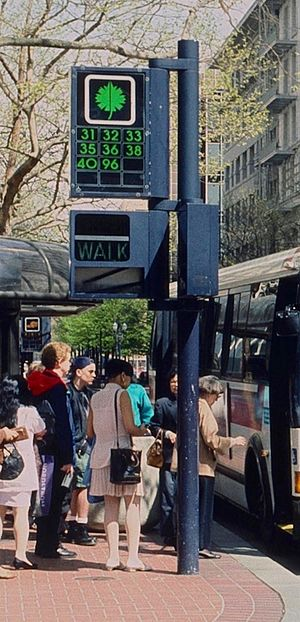 "Portland Transit Mall - Passengers boarding in 1993 at a stop marked by one of the eight ""sector symbols"""