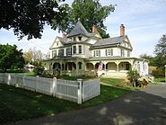 Green house with tree and driveway in Oldwick New Jersey