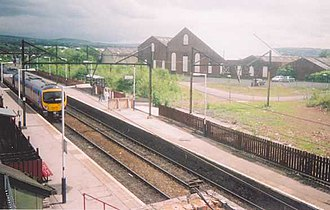 Guide Bridge railway station - Guide Bridge railway station, with a First TransPennine Express Class 185 Desiro unit passing through.