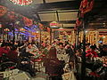 HK Disneyland USA Main Street Halloween night Oct-2013 restaurant interior visitors.JPG