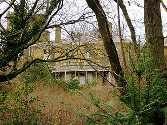 London Air Park - The house viewed through trees in 2014