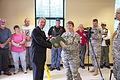 Harold Weinbrecht, mayor of Cary, N.C., presents U.S. Army Lt. Col. Laura Steele, 535th Military Police Battalion Commander, with a proclamation making June 8th Spc. Daniel Lucas Elliott day, during a ceremony 130609-A-IL912-089.jpg