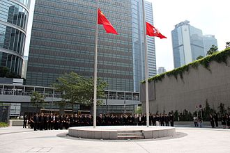 2012 Lamma Island ferry collision - Chief Executive Leung and other government officials observe three minutes of silence outside the Central Government Complex in Tamar, while the flags of Hong Kong and China are flown at half-mast