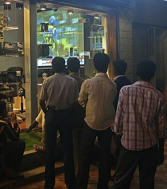 2011 Cricket World Cup Final - Indian fans view the match at a store in Bangalore